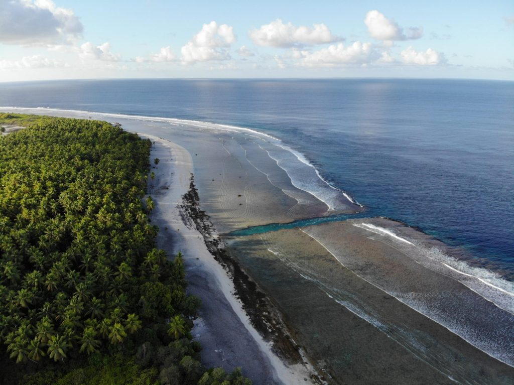A dynamited cut through the coral stone on Nikumaroro. The island used to be a coconut plantation; this cut was made to allow small craft to land.