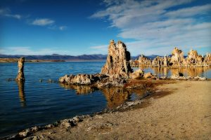 Image of California's Mono Lake taken from the brown rocky shore